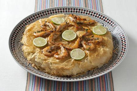 Fresh baked Moroccan fish pastilla Stock Photo - 28128181