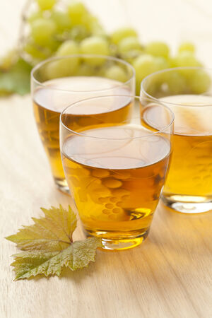 and grape juice:  Fresh white grape juice in a glass