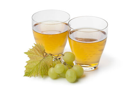 and grape juice:  Fresh white grape juice in glasses on white background