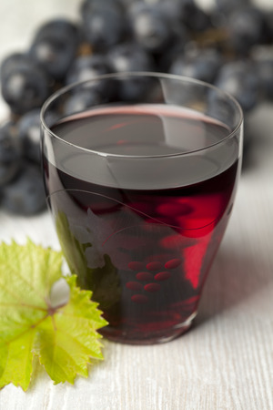 Fresh red grape juice in a glass