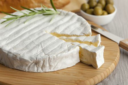 Fresh Brie cheese and a slice
