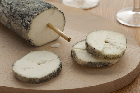 touraine:  Fresh Sainte-Maure de Touraine and a slice close up Stock Photo