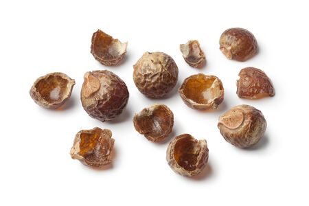 nutshells: Nutshells of soapnuts on white background Stock Photo