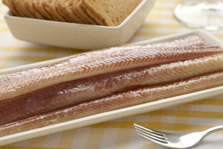 eel:  Dish with filleted smoked eel close up