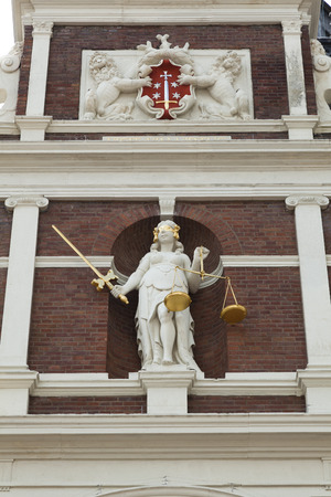 townhall: Statue of Lady Justice  on the facade of the townhall in Haarlem, Netherlands