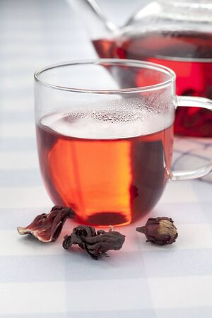 sepals: Cup of hot hibiscus tea and sepals