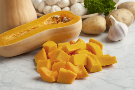 Fresh butternut pumpkin cut into pieces
