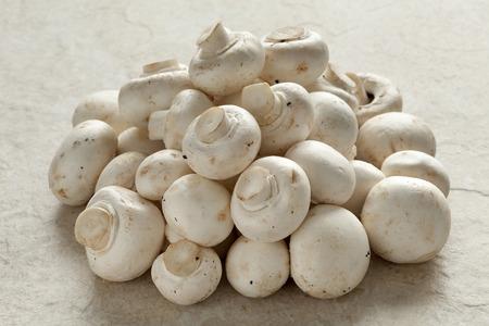 button mushrooms: Heap of fresh raw button mushrooms