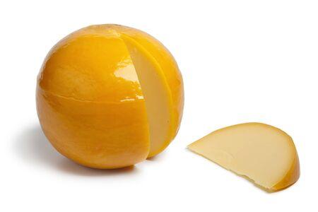 edam: Whole yellow round Edam cheese with a slice on white background
