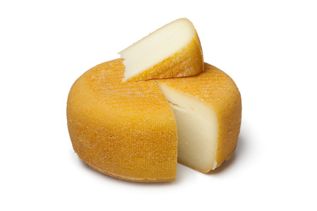 salut: Port salut cheese with a slice on white background