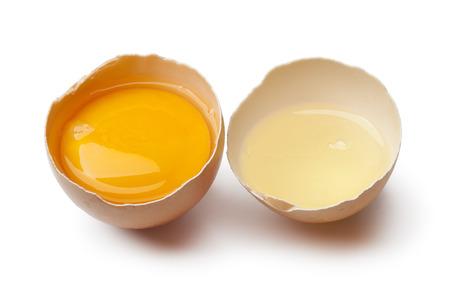 Egg yolk and white in a broken brown egg shell on white background