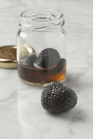 preserved: Whole preserved summer truffle from a pot