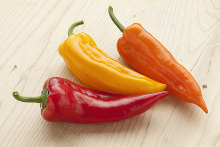 bell peppers: Fresh sweet red, yellow and orange pointed bell peppers