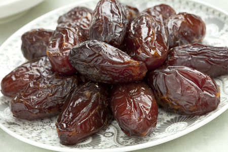 festive occasions: Dish with preserved ripe Medjool dates for festive occasions