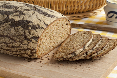 eating pastry: Traditional fresh german Krustenbrot and slices