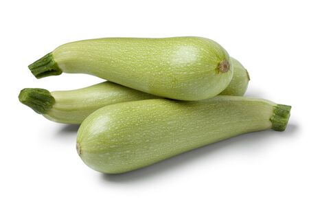 courgettes: Fresh raw green courgettes on white background
