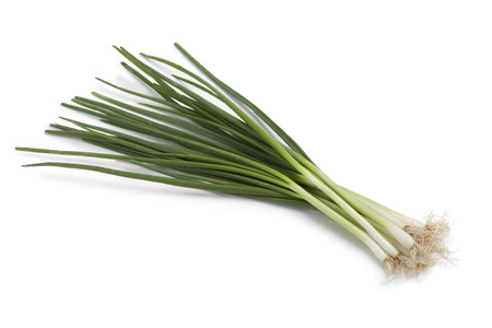 Bunch of fresh spring onions on white background Stock Photo