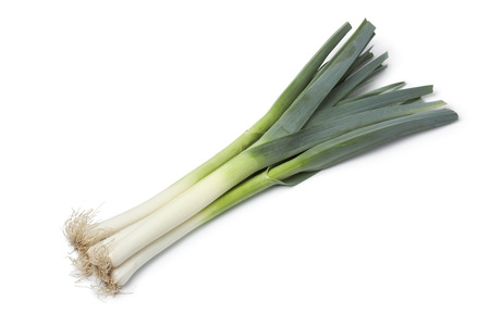 leek: Fresh leek stems on white background