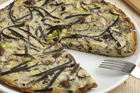 spring onions: Omelet with sea spaghetti, mushrooms and spring onions Stock Photo