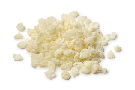 Heap of mastic tears of Chios on white background Standard-Bild