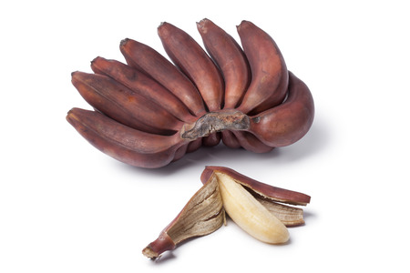 peeled banana: Bunch of fresh ripe red bananas on white background Stock Photo