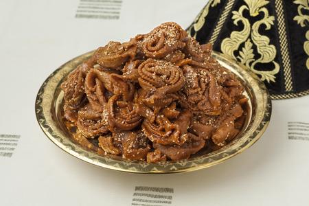 arabic food: Decoration tajine with fresh baked chebakia for ramadan