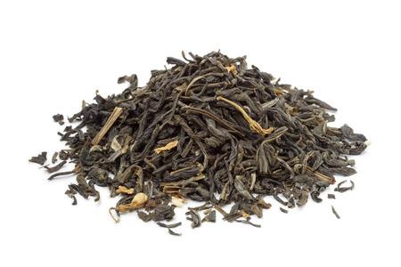 dried leaf: Heap of dried green tea on white background