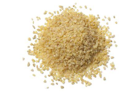heap: Heap of raw Bulgur on white background Stock Photo