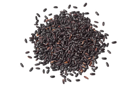 black rice: Heap of raw black venere rice on white background