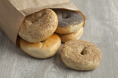 paper bag: Paper bag with fresh variety of New York bagels