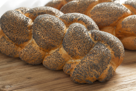 challah: Two whole fresh Challah breads with poppy seeds