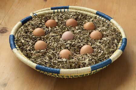 islam: Eggs in a basket with dried henna leaves as a symbol for a Moroccan wedding party