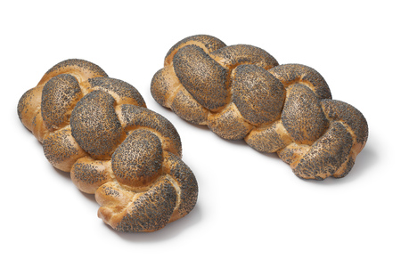 challah: Whole fresh Challah breads with poppy seeds on white background