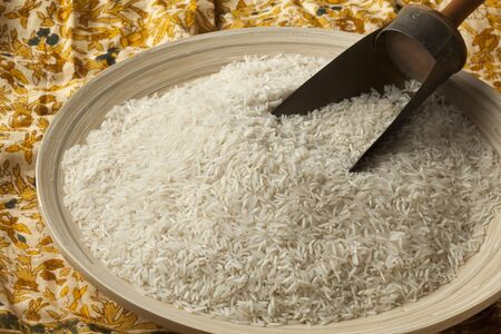 basmati rice: Bowl and shovel with raw Basmati rice Stock Photo