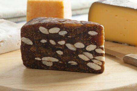 cheese board: Piece of fig bread on a cheese board Stock Photo