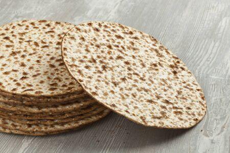 matzah: Pile of fresh wholewheat matzah close up