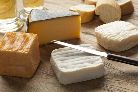 Traditional Belgian cheese board as dessert with beer and bread