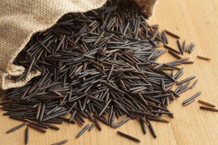 wild rice: Raw black wild rice from a jute bag