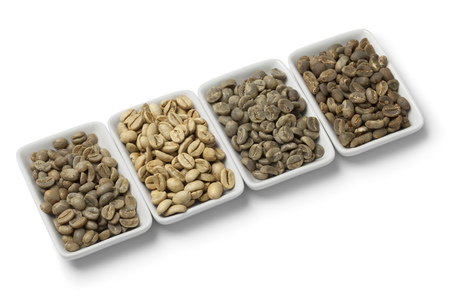 unroasted: Four kinds of green unroasted coffee beans on white background