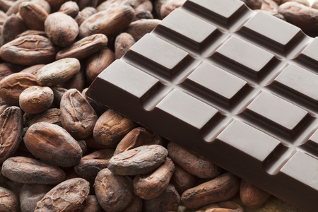 Bar of chocolate with raw cocoa beans Stock Photo