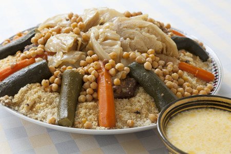 Traditional Moroccan couscous with buttermilk sauce in a bowl Stock Photo