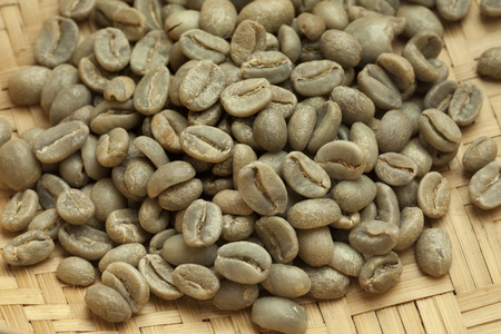 unroasted: Heap of Bolivian Yanaloma green unroasted coffee beans close up