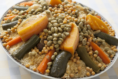 couscous: Festive Moroccan couscous with broad beans on a dish Stock Photo