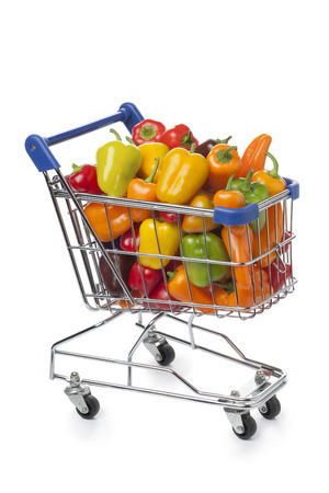 shoppings: Shopping trolley filled with colorful vine sweet mini peppers on white background