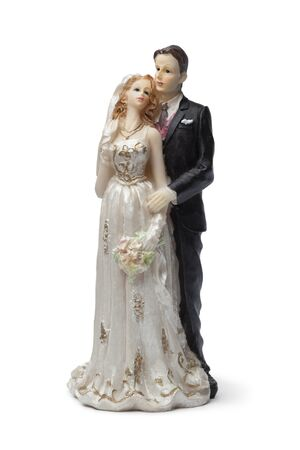 long lasting: Old bride and groom cake topper on white background Stock Photo
