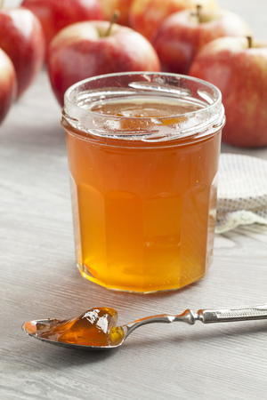 cider: Apple cider jam on a spoon Stock Photo