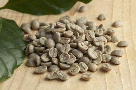 unroasted: Heap of Pamwamba green unroasted coffee beans Stock Photo