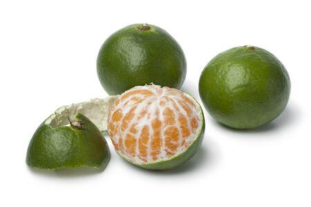 reticulata: Green and peeled satsuma fruit on white background Stock Photo