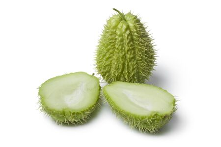 chayote: Whole and half spined fresh chayote fruit on white background
