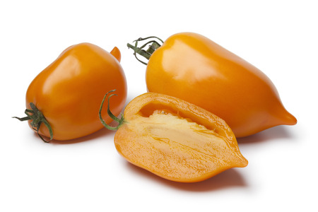 deformation: Whole and half fresh orange pepper- tomatoes on white background